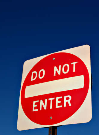 A Do Not Enter road sign against a deep blue sky Stock Photo