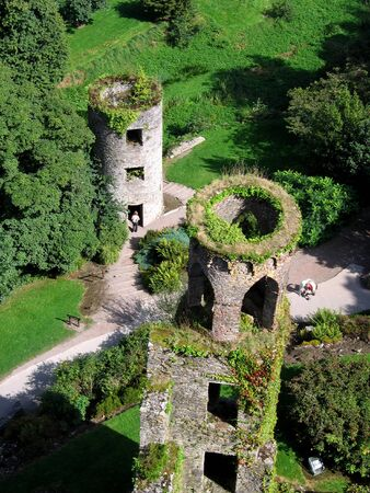 Aerial view of two of Blarney Castles towers and the lush green surroundings Stock Photo
