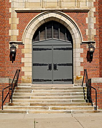 Gothic-style double doors at the front of a church in Northeastern Ohio Stock Photo