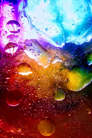 Abstract colorful Background Oil in Water surface Foam of Soap with Bubbles macro shot close-up. UHD.