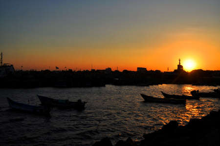 Sunset at a harbour in chennai india Stock Photo
