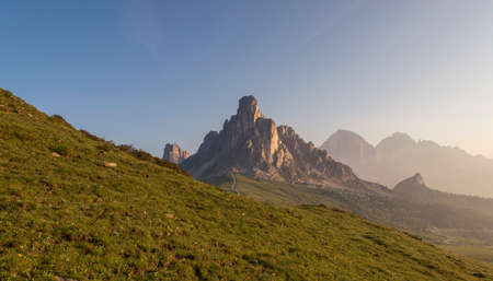 mountain pass: Mountain Panorama of the Dolomites as viewed from passo di Giau as viewed from the mountain pass Giau. Photograph was taken just after the sunrise from the top of the pass. Stock Photo