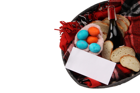 Easter. Easter table. Isolated easter with easter eggs, vine, bread and envelope with text. Stock Photo