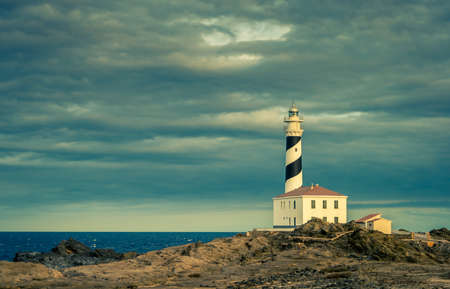 Beautiful and mysterious lighthouse in a cloudy day Stock Photo