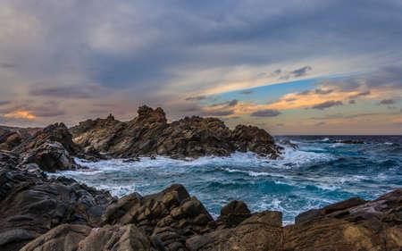 Sunseton over the sea and rocks