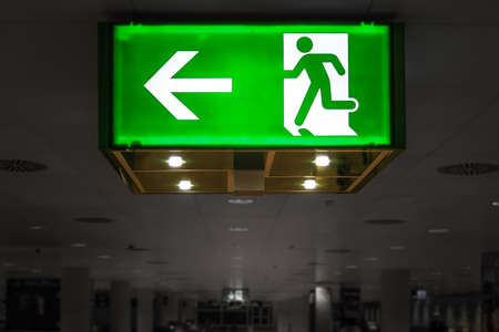 door casing: Green Exit Signal at the airport Stock Photo