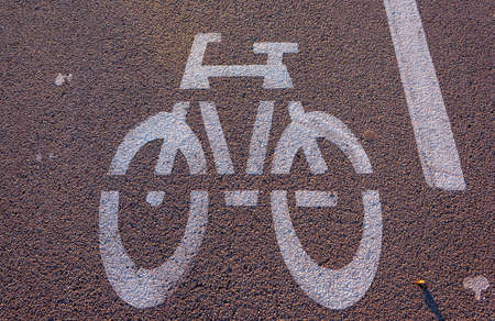 Withe bike signal on black asphalt and sunny day Stock Photo