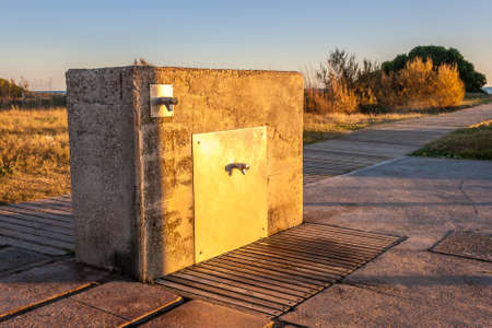 Artificial stone fontaine near the beach with the sunset