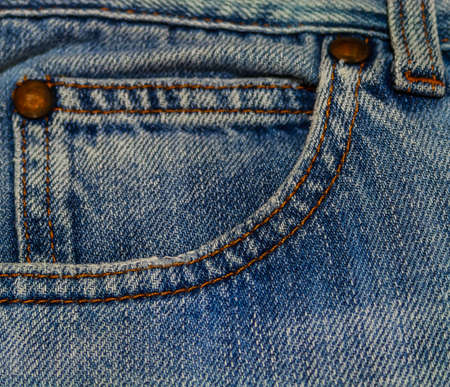 Blue jeans texture with close-up pocket and button