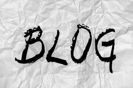 Hand made black blog letters on background crumpled paper