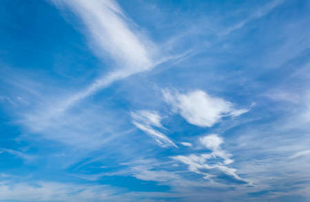 Blue sky with soft clouds on diagonal