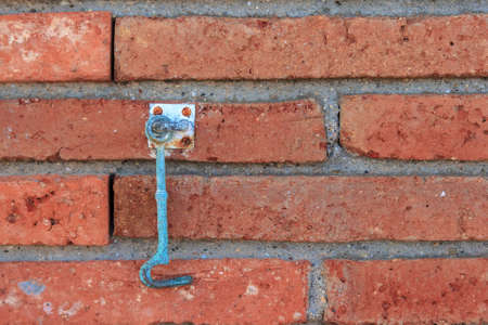 Old iron pin door on the brick wall Stock Photo