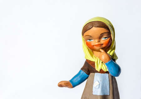 Cute girl figurine thinking with a country dress and yellow scarf on her head