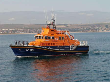 dorset: Lifeboat at sea off coast of Weymouth, Dorset