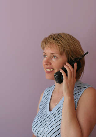attentiveness: The beautiful woman the manager speaks by phone at office.