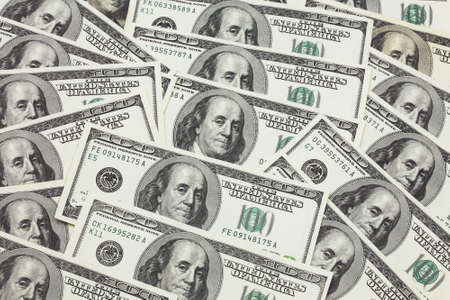 subsidize: Banknotes in 100 US dollars have put the friend on the friend and have made a background of money Stock Photo