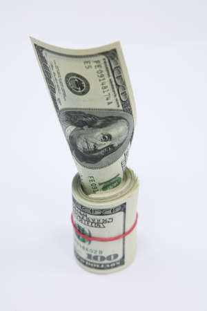 subsidize: Roll of banknotes by in 100 dollars and one banknote by in 100 dollars
