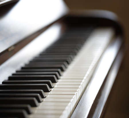 keyboard player: A photo of an old piano - close up