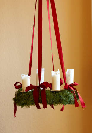 A photo of Advent wreath with big white candles