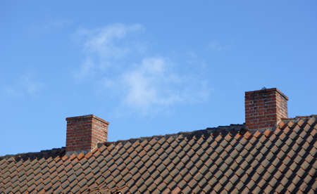 dilapidation: A typical chimney on a private house  Stock Photo
