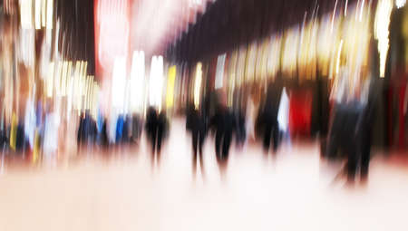 blur: A motion and lens burred image of people moving