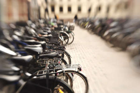 lots of parked bikes. Symbolic content. photo