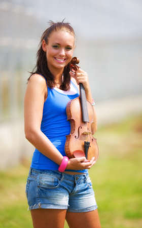 Young girl holding her violin photo