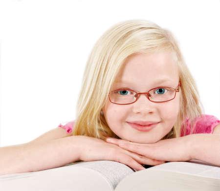 A cute little blond girl dreaming