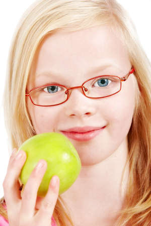 A cheerful and cute blond girl eating apple photo