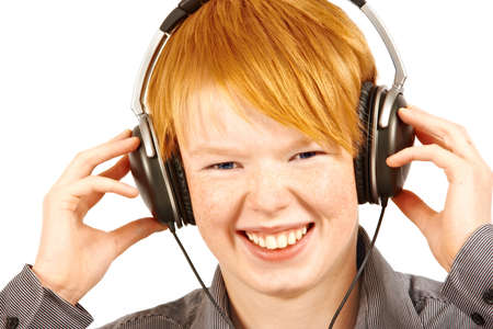 deafening: boy listening to music in headphones - isolated on white s