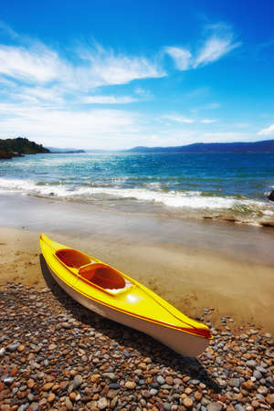a photograph of a yellow kayak on the beach Stock Photo - 9541419