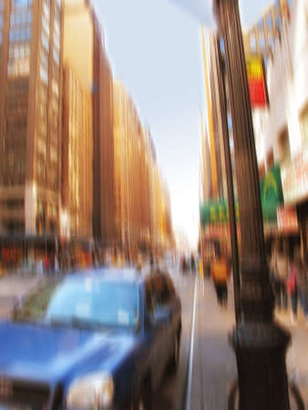 A motion blurred image of people  a Manhattan evening photo