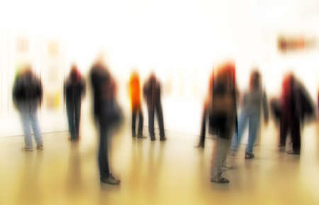 A motion blurred image of people at an exhibition photo