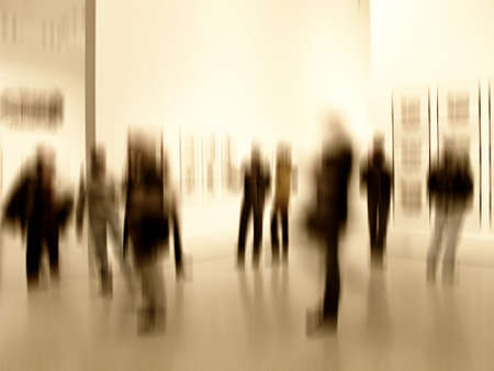 art gallery: A motion blurred image of people at an exhibition