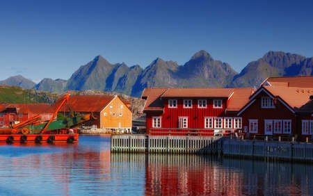a photo of Harbor houses in Svovlvaer, Lofoten, Norway  photo