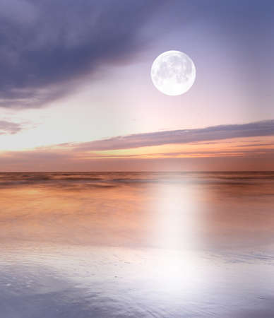 a photo of moonlight at the sea photo