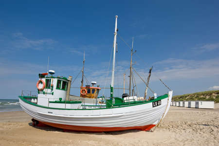 meer: a photo of fishing boats at the beach (Denmark)