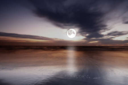 nighttime: a photo of moonlight at the sea
