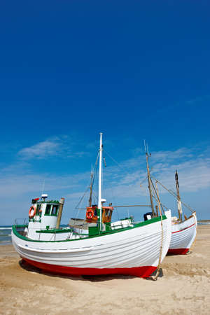 fishingboat: a photo of fishing boats at the beach (Denmark)