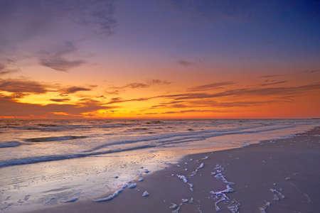 beach sunrise: a photo of dramatic ocean sunset