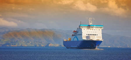 keel: A photo of a huge commercial boat and ferry