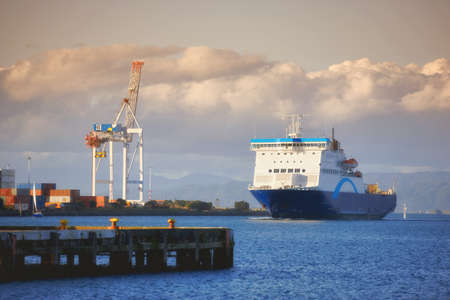 ferries: A photo of a huge commercial boat and ferry