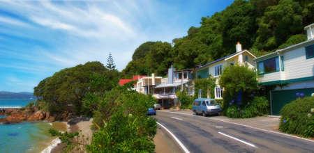 new zealand beach: A  photo of house and Coastline - Wellington, New Zealand