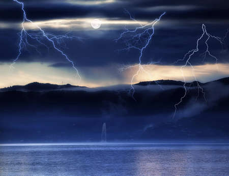 A photo of a sea, fog, mountains and thunder Foto de archivo