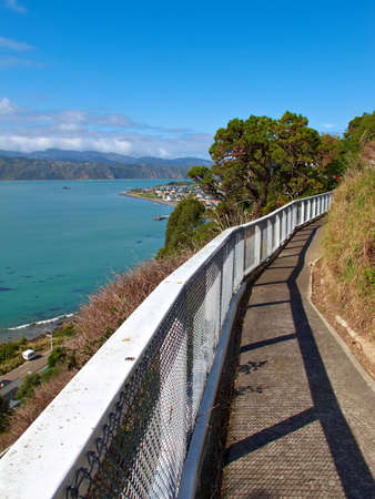 exhalation: A photo of a trail with wooden railings on a hill side