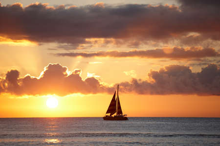 red sunset: A photo of Boat, ocean and sunset - Oahu, Hawaii