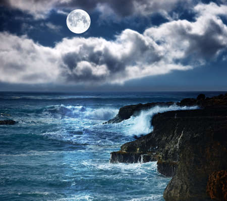 A photo of the moon  wild waves - Oahu, Hawaii Stock Photo