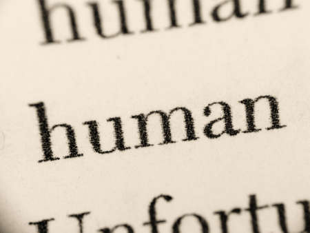 blurr: A macro photo of the word  human in a text