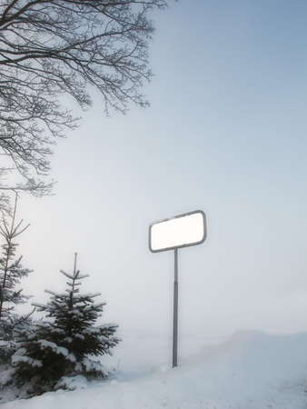 A photo of an empty sign post in winter time photo