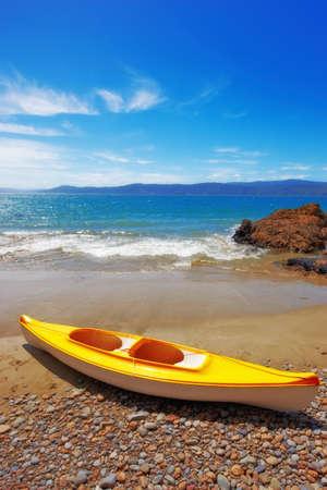 new zealand beach: Kayak on the beach - Karaka Bay, New Zealand